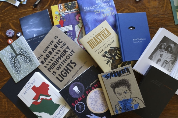 Books I brought home from the large book fair at AWP 2016.